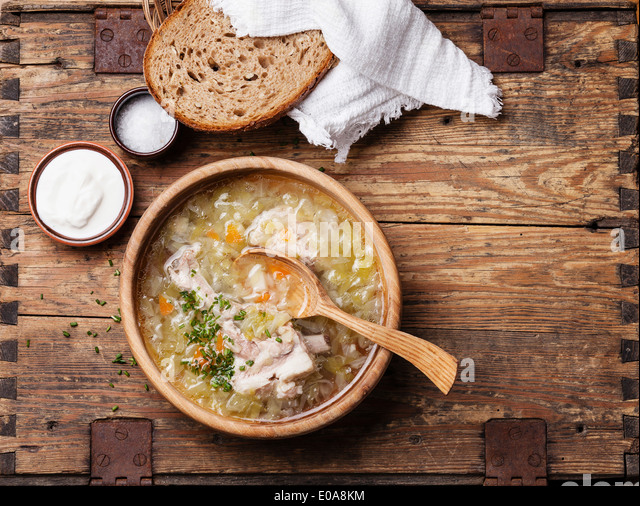 Homemade cabbage soup shchi with sour cream and bread - Stock Image