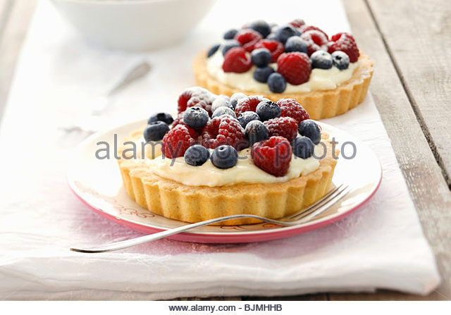 Creamy mixed berry flans - Stock Image