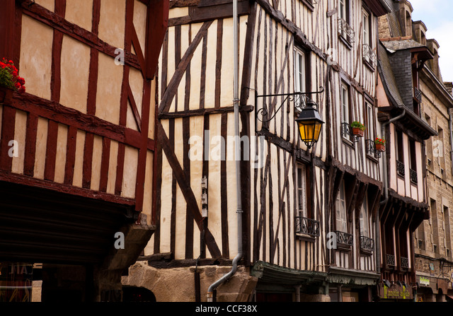 Medieval half timbered buildings in the walled town of Dinan, Brittany, France. - Stock Image