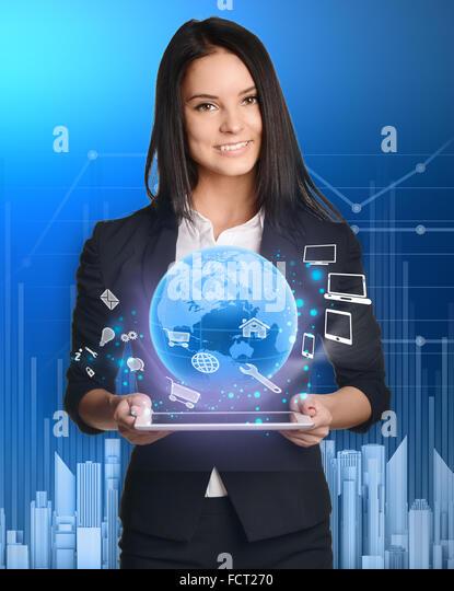 businesswoman with tablet pc against high-tech technology - Stock-Bilder
