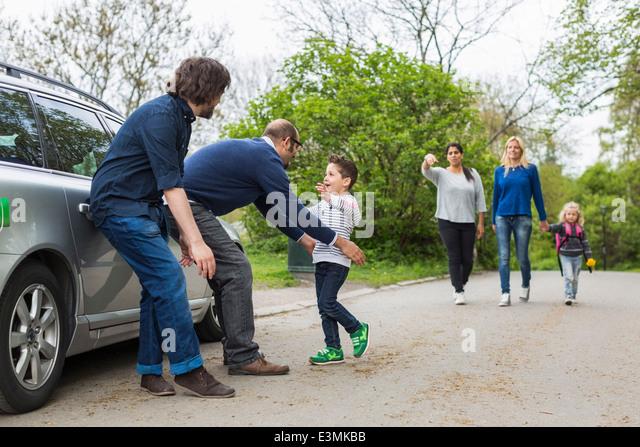 Homosexual families enjoying on street - Stock-Bilder