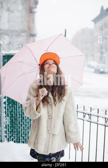 Young woman in the snow - Stock Image