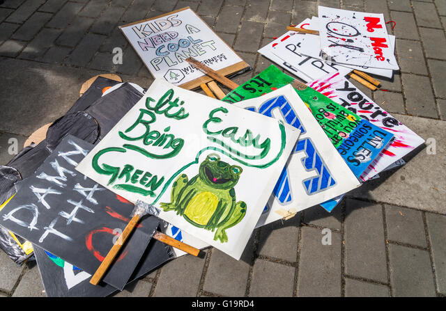 Pile of environmental protest signs, ready for Earth Day. - Stock Image