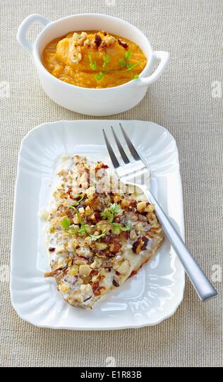 Sea bream with hazelnut crust,sweet potato mash - Stock Image