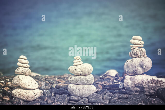 Color filtered image of stones on beach, spa concept background. - Stock-Bilder