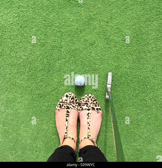 Feet and golf - Stock Image
