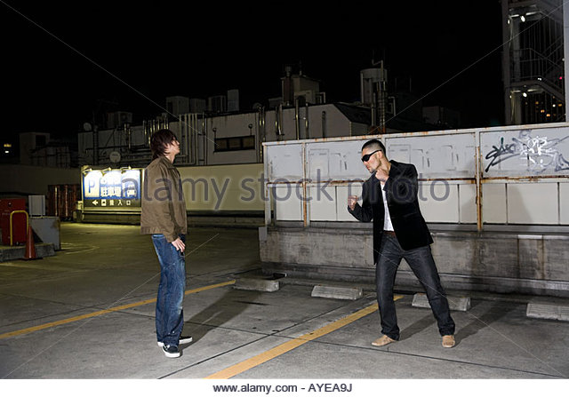Two young men fighting - Stock Image