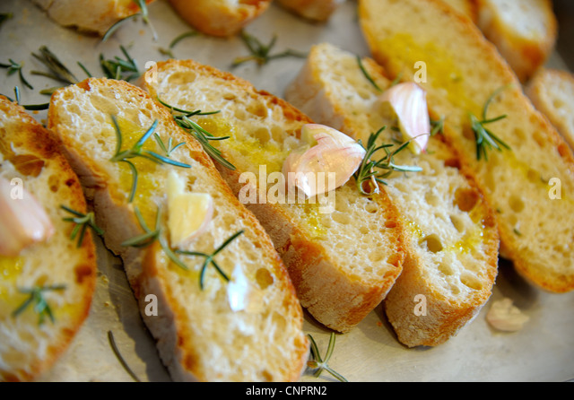 Bruschetta ( typical Italian Toasted Garlic Bread with oil ) - Stock Image