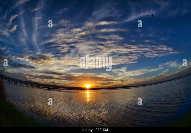 Fish-eye view of sunset at sea - Stock-Bilder