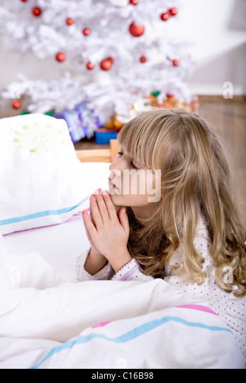 xmas praying - Stock Image