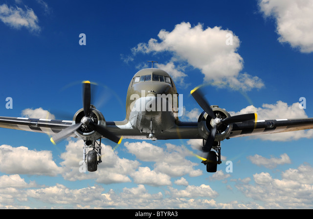 Vintage C-47 airplane landing during sunny bright day - Stock Image