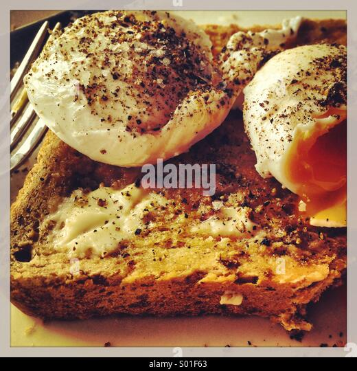 Poached Eggs on toast - Stock Image