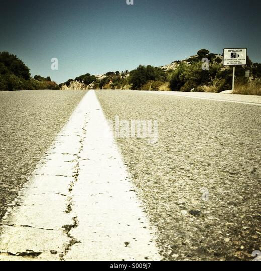 Asphalt road and speed camera sign. Low angle view. Square format. - Stock Image