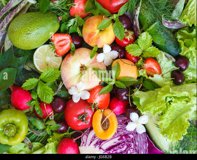 Summer fruits and vegetables. Love for a healthy vegan food concept. - Stock Image