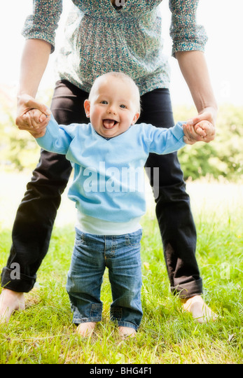babys first steps - Stock Image