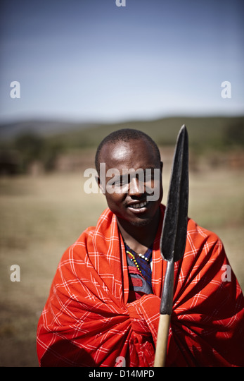 Maasai man holding shovel - Stock Image