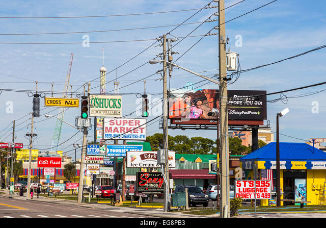 Advertising billboards on International Drive, Orlando, Florida, America - Stock Image