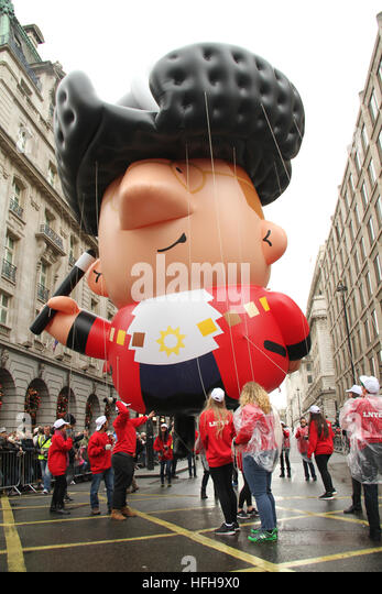 London, UK. 1st January 2017. A giant float seen by The  Ritz during in London New Year's Day Parade in London - Stock Image