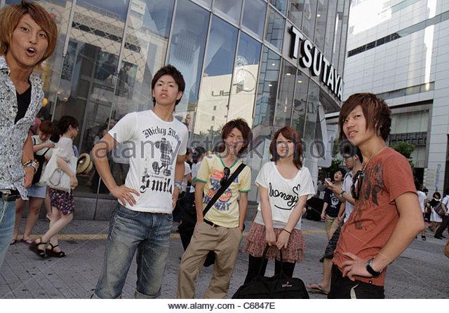 Tokyo Japan Shibuya Shibuya Crossing kanji hiragana katakana characters symbols Japanese English shopping business - Stock Image