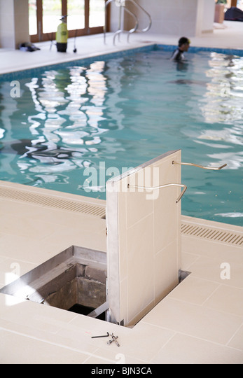 Swimming Pool Service Worker : The trap door stock photos images