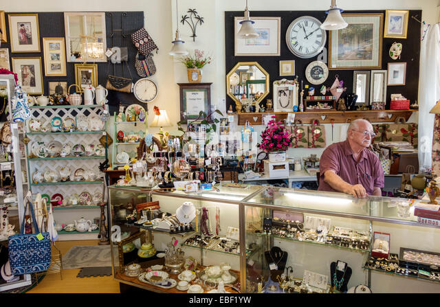 Clermont Florida Montrose Street historic downtown collectibles antiques store senior man owner business inside - Stock Image