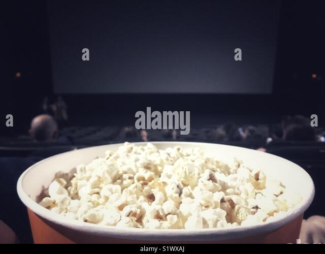 Popcorn bowl at the movie theather - Stock Image