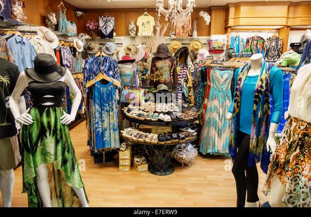 Hawaii Hawaiian Oahu Honolulu Waikiki Beach shopping woman's clothing fashion store sale display mannequin - Stock Image
