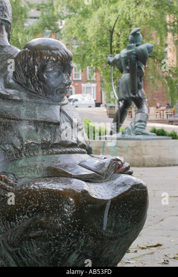 Friar Tuck Statue, outside Nottingham Castle, UK.  In the background can be seen the Robin Hood statue - Stock Image