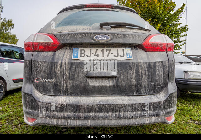 Very dirty Ford C-Max car, France. - Stock Image