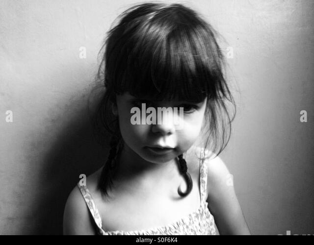 Unhappy 3-year old girl - Stock Image