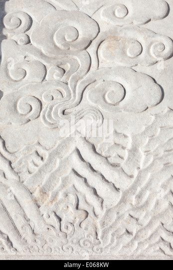 Detail of carved stine staircase depicting water, mountains  and clouds in the forbidden city - Stock-Bilder