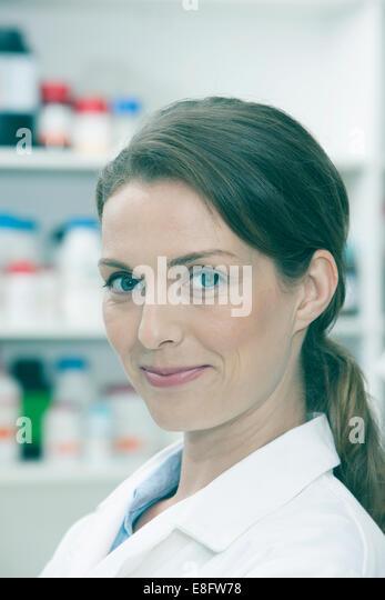 Portrait of chemist in laboratory - Stock Image