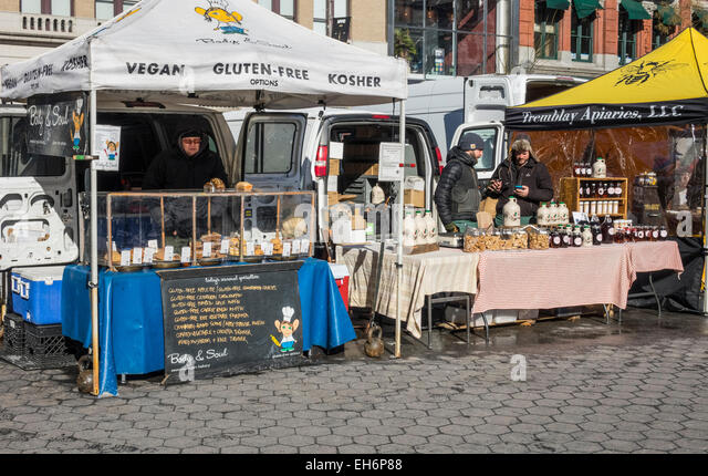 Vegan, gluten-free, and kosher food sold at a stall in the Union Square Greenmarket in New York City in winter - Stock Image