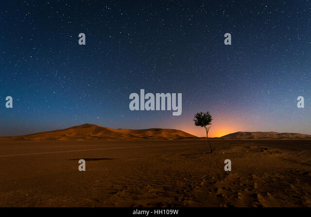 The dunes in Erg Chebbi in Morocco at night wih the sky full of stars - Stock Image