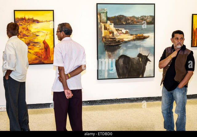 India Indian Asian Mumbai Fort Mumbai Kala Ghoda Jehangir Art Gallery contemporary paintings man friend looking - Stock Image