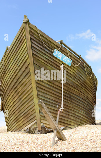 the jolly roger pirate ship with blue sky background - Stock Image
