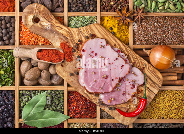 still life with boiled pork meat and spices - Stock Image