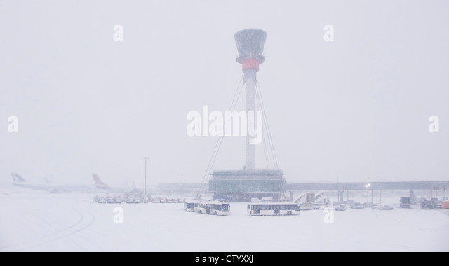 Air control tower and airport in snow - Stock Image
