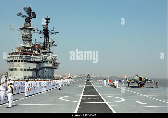 Indian navy sailors ready for guard of honour on the deck of aircraft carrier INS viraat R22 Mumbai - Stock Image