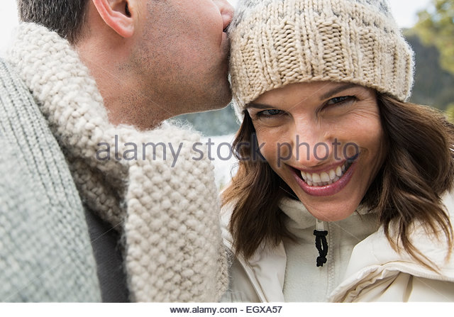 Portrait of enthusiastic couple wearing warm clothing - Stock Image