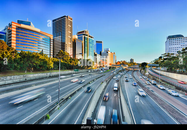 Wide view of multi lane Warringah freeway going through North SYdney during morning rush hour traffic peak and congestion - Stock Image
