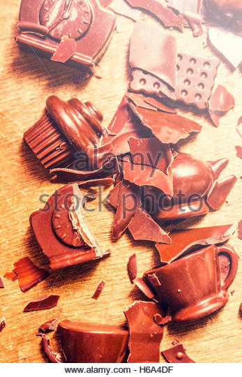 Domestic disturbance concept in a broken chocolate disaster of smashed tableware in shapes and forms of kitchen - Stock Image