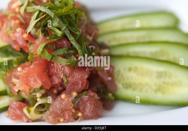 Ahi tuna poke and cucumber salad, close up - Stock Image