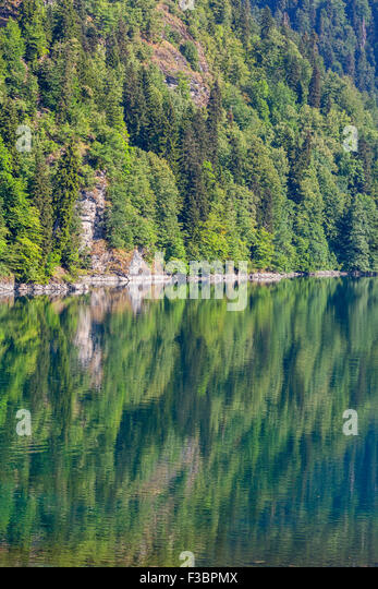 Scenery view of colorful mountain lake with crystal water and beautful reflections - Stock Image