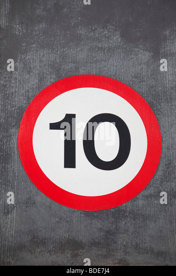 Speed restriction sign reads 10 MPH. - Stock Image