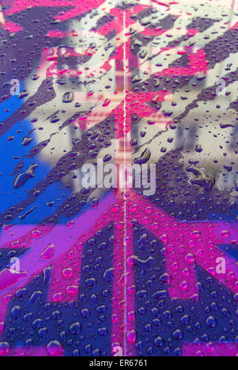 Reflection of buildings in the glass of Riga with Latvian national symbols and raindrops - Stock Image