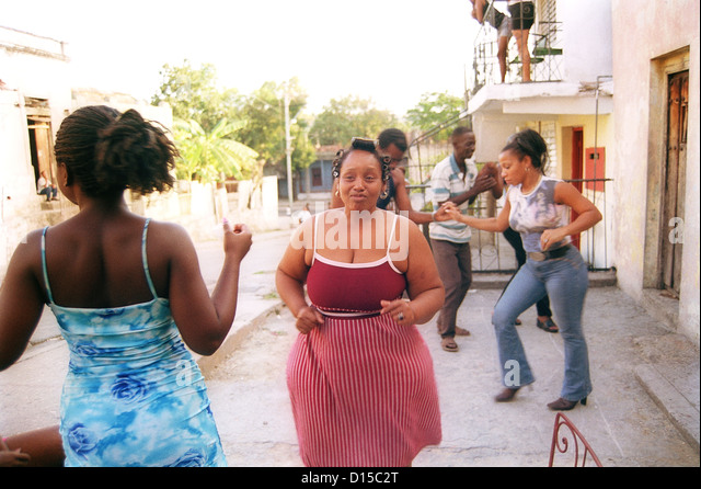 Santiago de Cuba, Cuba, people dancing in the street - Stock Image