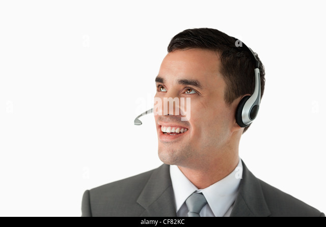 Close up of young male professional with headset on - Stock Image