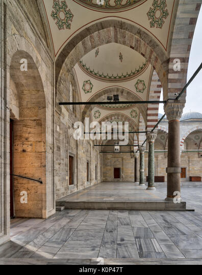 Passage leading to Fatih Mosque, a public Ottoman Baroque style mosque, with columns, arches and marble floor, Fatih - Stock Image