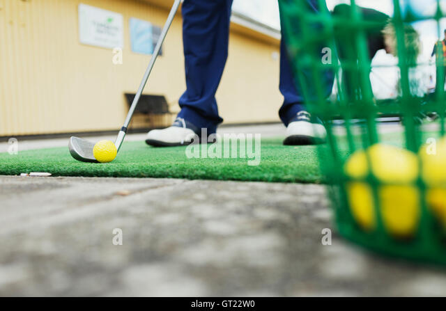 Low section of man playing golf at driving range - Stock-Bilder